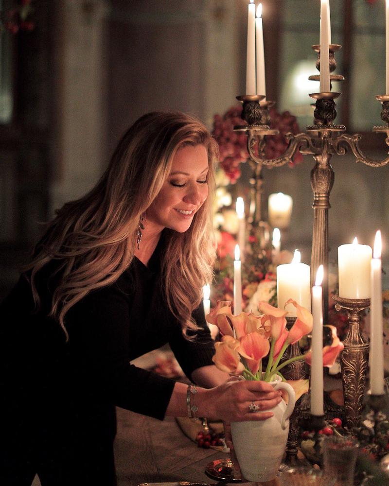 Wedding planner, Michelle Durpetti, arranging floral design.